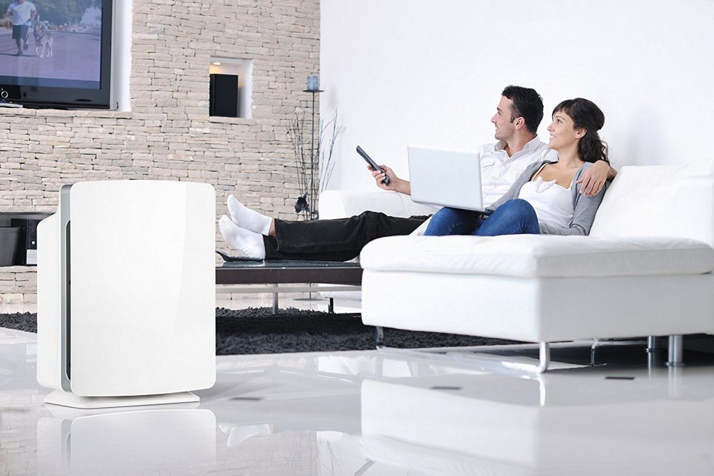 Air Purifier in the Home with Family on Sofa